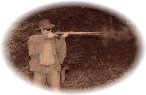 Me firing a .50 cal black powder rifle
